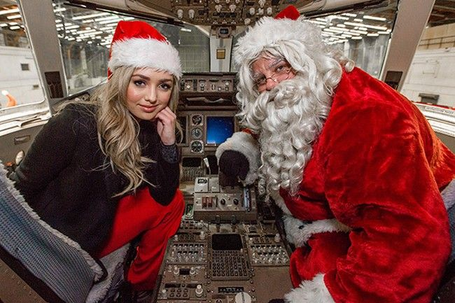 Peyton List snuggles up with Santa in the cockpit