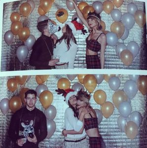 Taylor Swift poses with Nick Jonas & Olivia Culpo